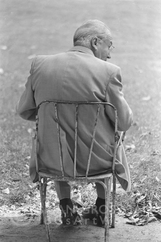 B&W Photograph - Man on a Chair by Brian Grossman