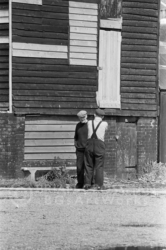 B&W Photograph - Two Guys Talking Crops by Brian Grossman