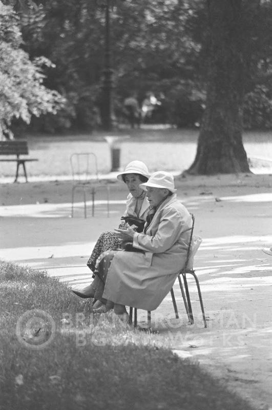 B&W Photograph - Two Women Feet in the Grass by Brian Grossman